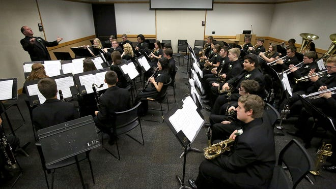 Director Todd Zimbelman prepares the West Salem High School Wind Ensemble in the warms-up room at the 2015 OSAA Band State Championships on Saturday, May 16, 2015, in Corvallis. West won its sixth state title in a row.