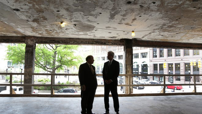 Detroit Mayor Mike Duggan, left, and JPMorgan Chase Chairman and CEO Jamie Dimon after a ceremony marking the start of renovation at 1145 Griswold in Capitol Park. Formerly known as the Capitol Park Building, it is being remade as 63 market-rate apartments and commercial space.