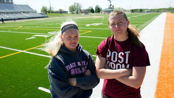 Solon throwers Katy Misel, left, and Shelby Gunnells pose for a photo on Monday, May 18, 2015.