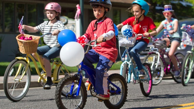 P.J. Niethe, 8, of Point Pleasant Beach leads bikers down Arnold Avenue. The Point Pleasant Beach Memorial Day Weekend Bike Parade heads down Arnold Avenue.Point Pleasant Beach, NJSaturday, May 23, 2015Doug Hood/Staff Photographer@dhoodhood