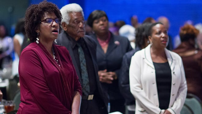 """Attendees join together to sing """"Lift Every Voice and Sing"""" at the 52nd Annual Jackson-Madison County NAACP Freedon Fund Banquet at the Carl Perkins Civic Center."""