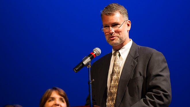 Superintendent Stephen Murley welcome guests to Tate High School's commencement ceremony at the Englert Theatre on Wednesday, May 27, 2015.