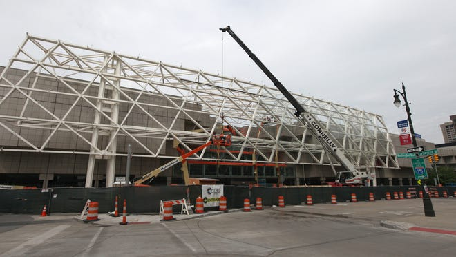 Crews from Enclose Corp. are working full speed on the Cobo Center video wall that will carry messages promoting Detroit events. It is expected to be completed by June 30.