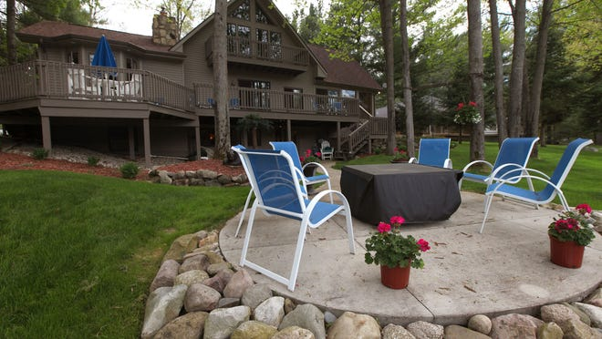 Cottage home in Gladwin overlooks the water at Second Lake. It is listed for $325,000.
