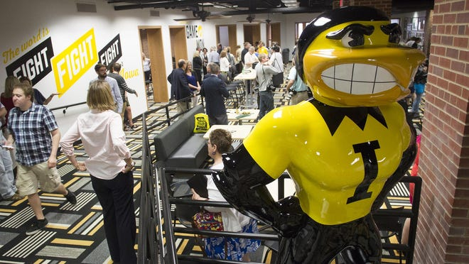 Guests attend the re-opening celebration of the Iowa Memorial Union ground floor on Wednesday, June 3, 2015.