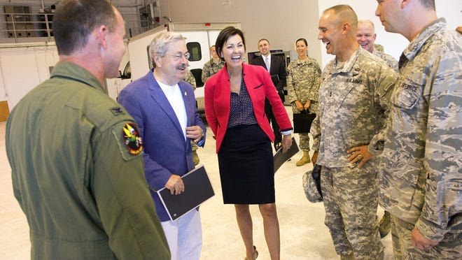 Iowa Gov. Terry Branstad and Lt. Gov. Kim Reynolds share a laugh as they tour the 132nd Wing at the Iowa Air National Guard on Tuesday, June 9, 2015.