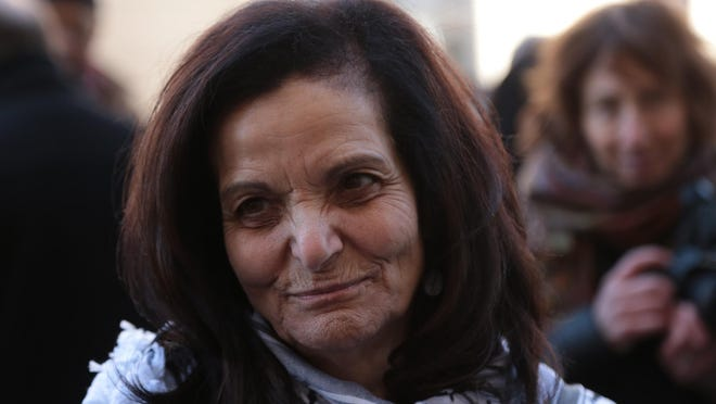 Palestinian immigrant Rasmieh Odeh, 67, thanks supporters outside of Federal Court in downtown Detroit after sentencing on March 12.
