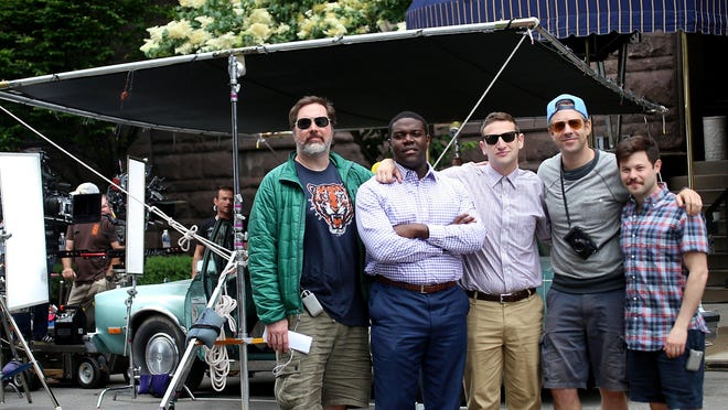 """The cast of the Comedy Central pilot, """"The Detroiters"""" (from the left) Joe Kelly, Sam Richardson, Tim Robinson, Executive Producer Jason Sudiekis, and Zach Kanin stand in front of the historic Detroit Club in downtown Detroit, where they film a scene on Friday, June 12, 2015. Richardson and Robinson are real-life, former Detroiters."""
