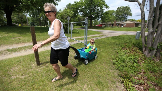 "Joyce Esper,76, pulls her great grandson Bryson Crammer, 4, in his wagon on their way to the park near her home in Highland Mich. Esper got herself tested for Alzheimer's after a bout of forgetfulness. She was relieved when she got the call telling her she didn't qualify as a candidate for an international study being conducted. "" I came to the conclusion that i was having brain overload, that's why i was forgetting things at that time"". said Espers on Thursday, June 4, 2015"