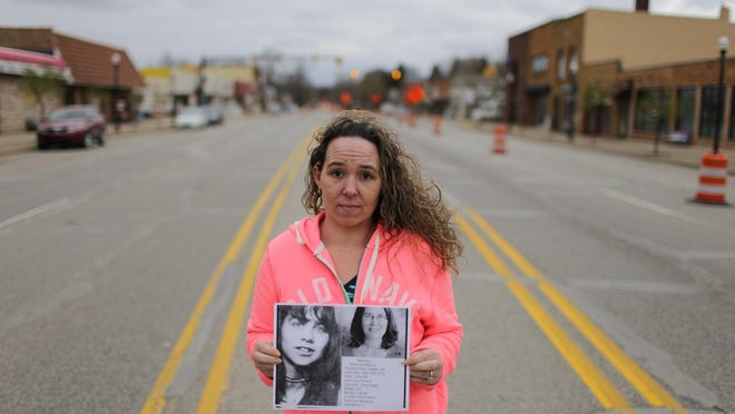 Shannon Froeber 32 of Hamilton holds a photo of the missing Kathy Sue Wilcox on Tuesday April 21, 2015 who disappeared from Otsego 42 years-ago without a trace while standing in downtown Otsego. Froeber, who grew up in Otsego, began a quest to find out more about her and help her sister solve the mystery of what happened to her.