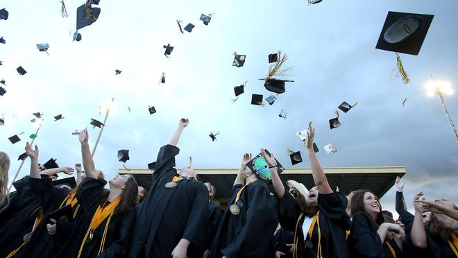 Cascade High School students celebrate after their commencement ceremony on June 3 in Turner.