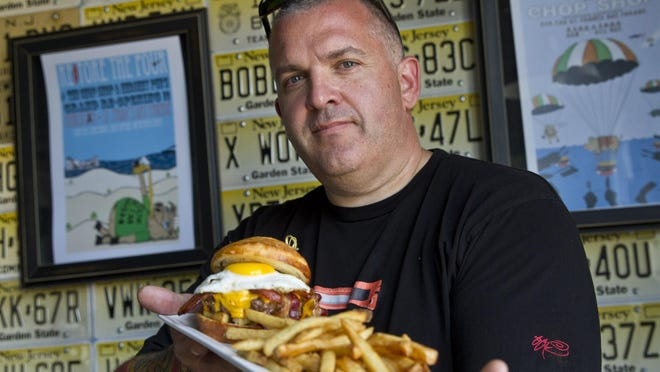 Keith Morris, the owner of Chop Shop in Seaside Heights, shows his Brunch Burger.