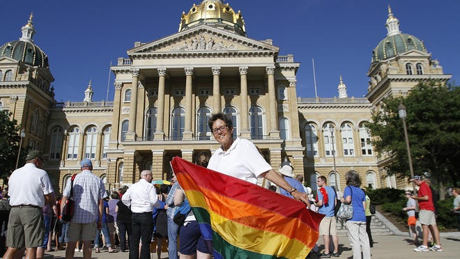 Sumitra Red Wing carries a rainbow flag in front of the state capitol building on June 26, 2013. Hundreds of supporters of the LGBT community celebrated on the grounds of the Capitol in Des Moines in response to the ruling of the Defense of Marriage Act unconstitutional by the U.S. Supreme Court.
