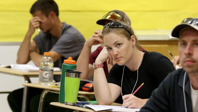 Sarah Gray, with the U.S. Fish and Wildlife Service, listens to an instructor before taking a test Thursday, June 25, at the Mid-Willamette Valley Fire School in Sweet Home.