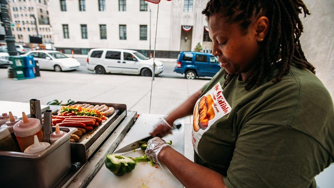 Qui'Vonta Job,42, of Detroit chops up ingredients on June 25th, 2015 in Detroit, for her hot dog grill in downtown.