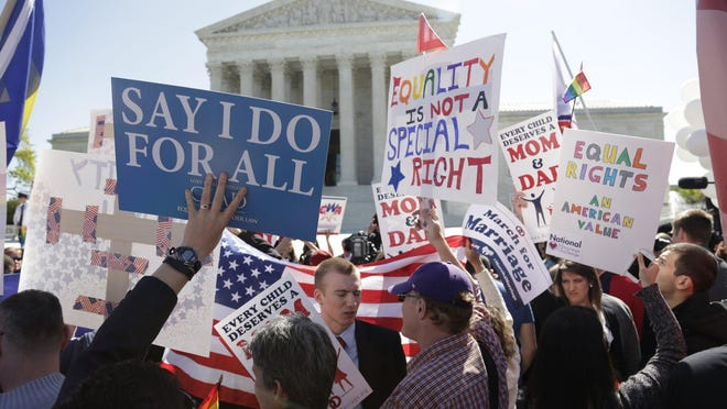 Protesters and supporters of same-sex marriage stand on the steps of the U.S. Supreme Court in Washington, D.C., on April 28.