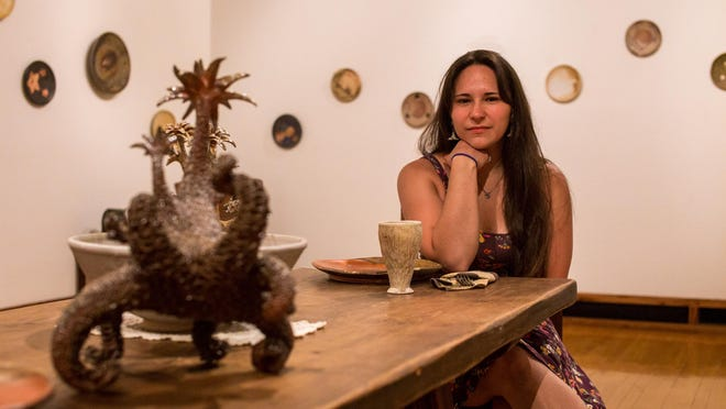 "Paris Gibson Square Museum of Art's resident artist Danielle O'Malley sits at a table in the middle of her exhibit ""Sunken and Discovered"" on June 24, 2015."