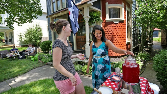 Missy Berg (left) talks with Fae Ehsan as she sets up for her Porch Party on Sunday, July 12, 2015. Porch parties around the city were part of the City Gallery at the Harrison Center for the Arts initiative encouraging residents to gather for neighborly fun.