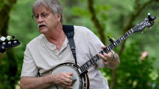 Donn Whitten plays banjo with the Roadhouse band Sunday at the sixth annual Historic Silver Falls Days at Silver Falls State Park.
