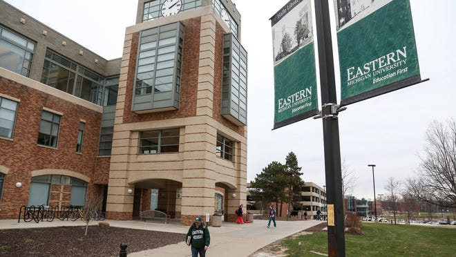 Students walk past the Halle Library on the Eastern Michigan University campus in Ypsilanti on Thursday April 16, 2015. Picture taken by Ryan Garza/Detroit Free Press