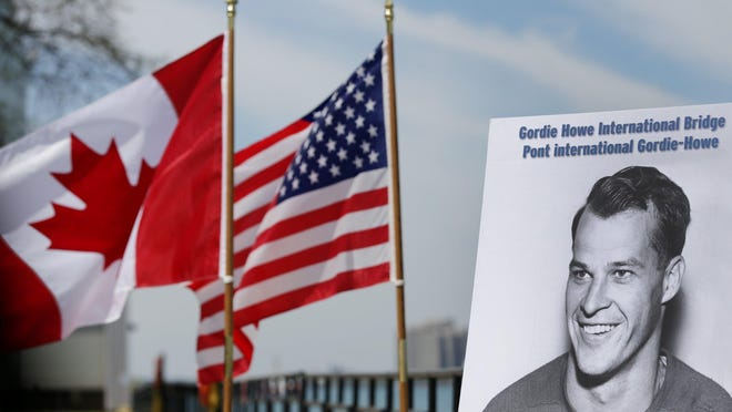 A photograph of Gordie Howe stands on the riverfront after a press conference announcing that the future publicly owned bridge between Windsor, Ontario and Detroit, Michigan would be named Gordie Howe international bridge in Windsor, Canada on Thursday, May 14, 2015.