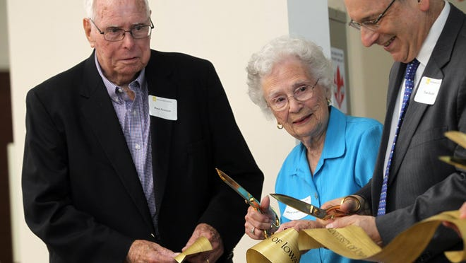 Mary Louise Petersen and her husband Rand take part in the ribbon-cutting ceremony for the Mary Louise Petersen Residence Hall on Tuesday, July 21, 2015.