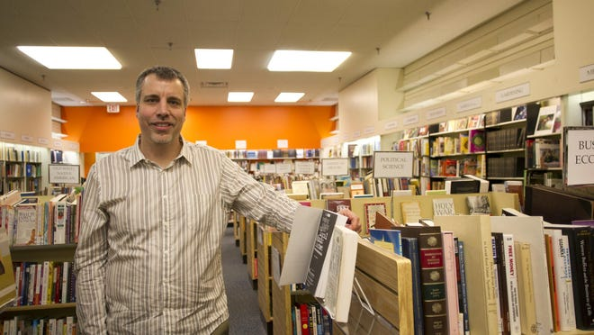 Greg Delzer is seen at Defunct Books on Friday, April 12, 2013, in this Press-Citizen file photo.