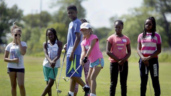 Golf students watch Alyssa Flores, 9, of Grosse Pointe Park take part in the chipping contest at the LPGA-USGA girls golf program at the Belle Isle Golf Center in Detroit on Monday, July 20, 2015.