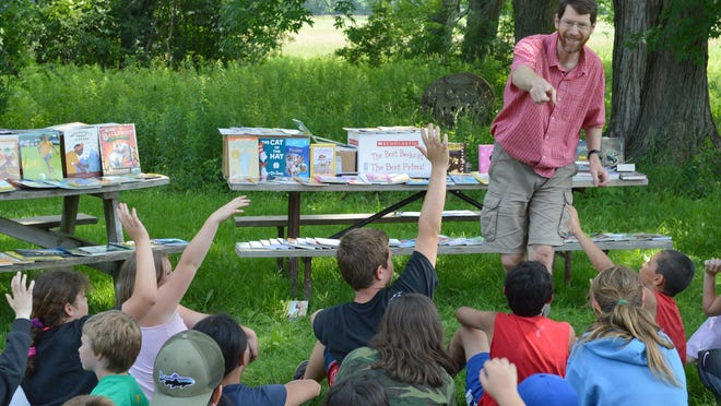Children's Literacy Foundation (CLiF) Executive Director Duncan McDougall talks to kids about reading at the Greater Burlington YMCA's Camp Greylock in Ferrisburgh.
