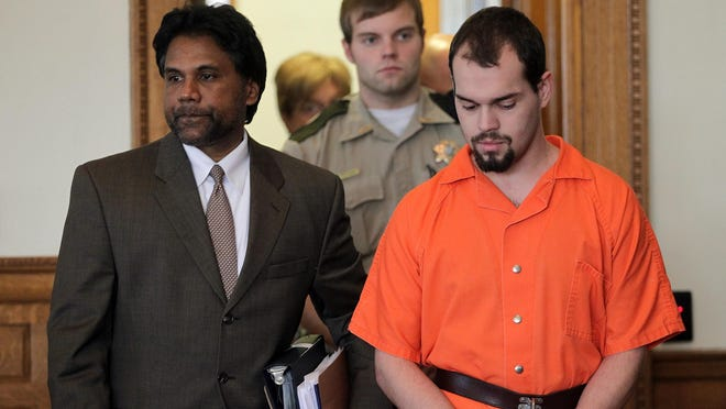 Johnson County public defender Peter Persaud escorts Alexander Kozak of North Liberty to his case management conference at the Johnson County Courthouse on Monday, Aug. 3, 2015. Kozak is accused of the murder of Andrea Farrington and pleaded not guilty to first-degree murder. David Scrivner / Iowa City Press-Citizen