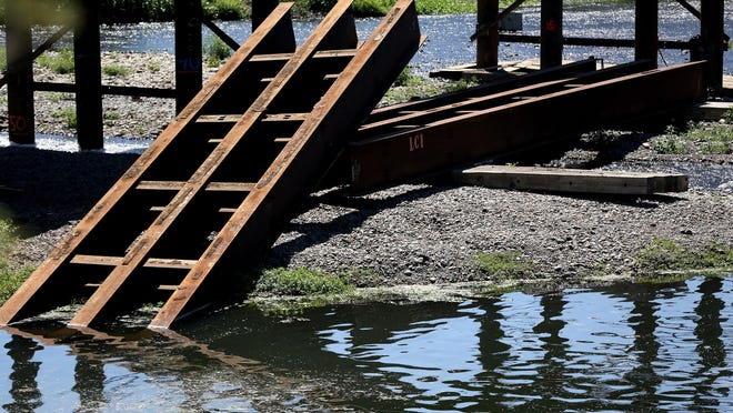 A cable of a large crane carrying a 55 foot, 20,000 pound beam snapped June 29, dropping the beam into the Willamette Slough in Salem. Photographed on Wednesday, Aug. 5, 2015.