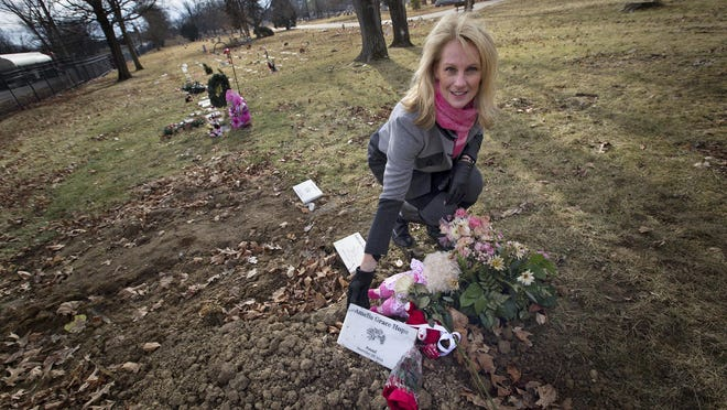Linda Znachko, shown in January near a headstone her organization provided for a baby's grave, will provide a headstone for the grave of the first black person dedicated in Indianapolis' Crown Hill Cemetery.