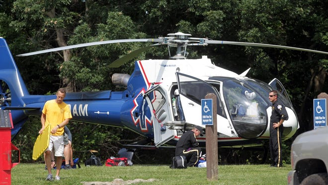 Emergency responders set up at the Lake Macbride beach in Solon on Thursday, Aug. 6, 2015.
