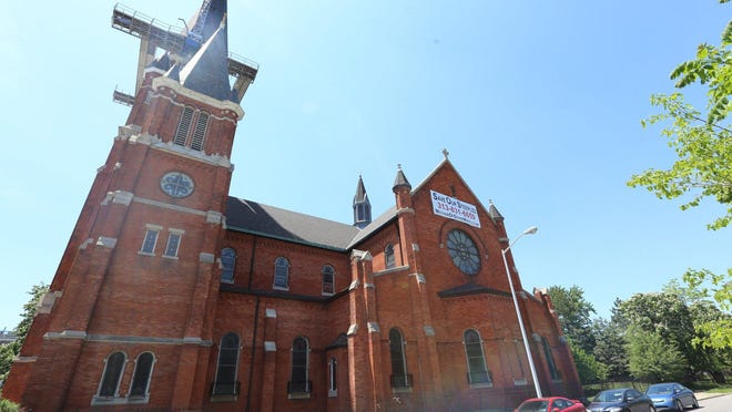 St. Josaphat Catholic Church, its iconic steeple now fully repaired after high winds nearly toppled it in November 2013, will host the 15th Detroit Mass Mob at Sunday's noon mass.