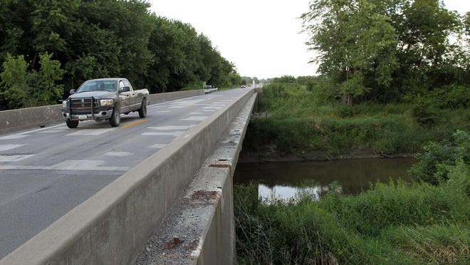 Cars drive over Old Man's Creek on Highway 1.