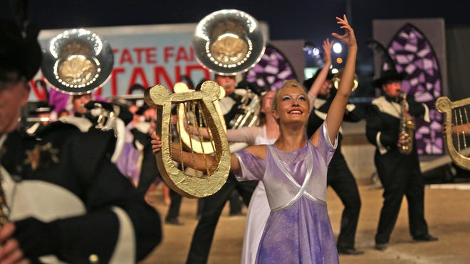 Members of the Winchester Community High School Marching Band perform Saturday, Aug. 8, 2015, during the Sweet 16 round of the 69th Music for All Indiana State Fair Band Day.