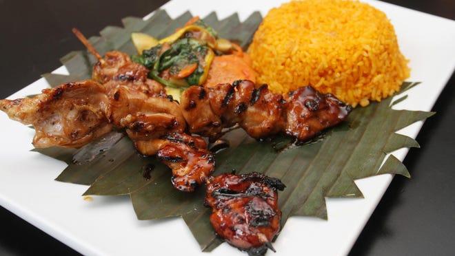 Pork barbeque combo by chef Homer Reyes at La Parilla de Manila, Wednesday, Aug. 19, 2015, in Colonia, NJ.