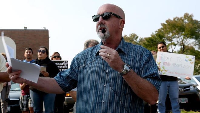 Rep. Bill Post speaks during a protest of Planned Parenthood by anti-abortion activists in Salem on Saturday, Aug. 22, 2015.