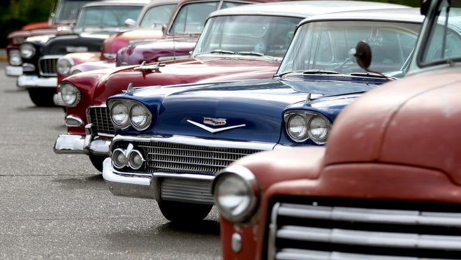 Cars are on display during the Cruise Salem mid-century car show at the Oregon State Capitol in Salem on Saturday, Aug. 29, 2015.