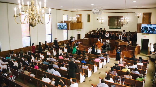 Historic First Baptist Church celebrates the congregation's return to their newly renovated sanctuary on Sunday.