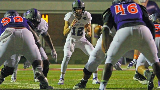 Central Arkansas' Hayden Hildebrand waits on the snap during last season's 49-21 win at Northwestern State.