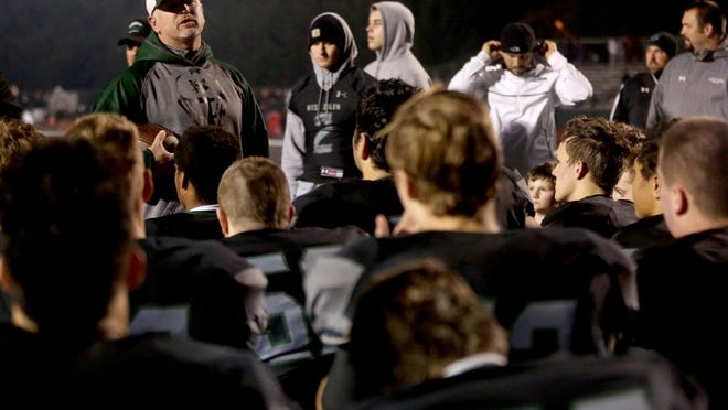 West Salem head coach Shawn Stanley speaks to his team after the Franklin vs. West Salem football game in the first round of the class 6A state playoffs at West Salem High School in Salem on Friday, Nov. 6, 2015. West Salem won the game 32-0.