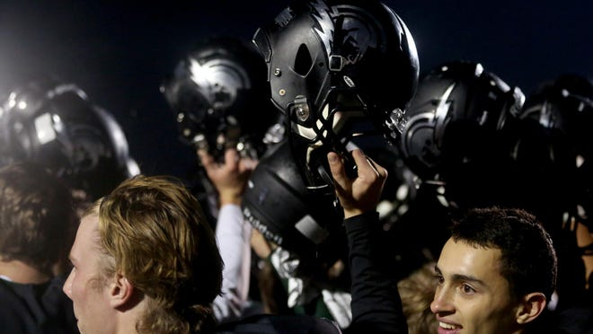 West Salem players celebrate their win after the Franklin vs. West Salem football game in the first round of the class 6A state playoffs at West Salem High School in Salem on Friday, Nov. 6, 2015. West Salem won the game 32-0.