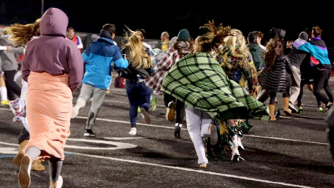 West Salem fans rush the field after the Titans victory in overtime of the Central Catholic vs. West Salem boy's soccer game in semifinals of the class 6A state playoffs at West Salem High School on Tuesday, Nov. 10, 2015. West Salem won the gam2-1 in overtime. The Titans will play in championship game on Nov. 14.