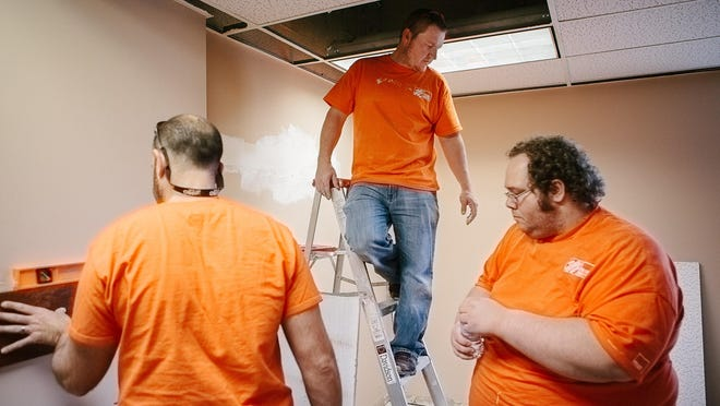 Home Depot and Leadership Jackson team up to renovate a room at the Dream Center on Friday.