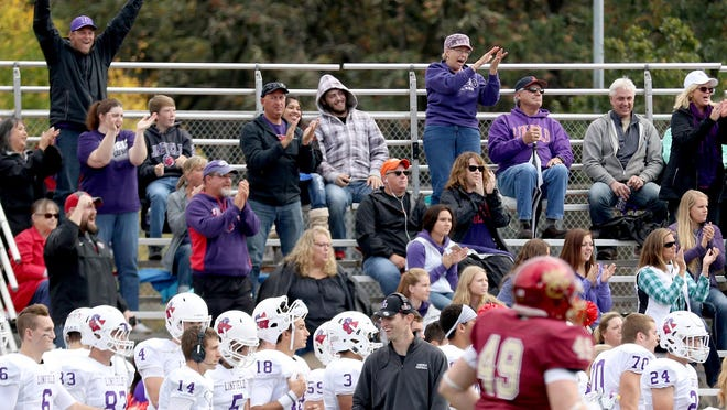 Linfield fans celebrate a play in the Linfield vs. Willamette football game at McCulloch Stadium in Bush's Pasture Park in Salem on Saturday, Oct. 17, 2015. Linfield won the game 49-7.