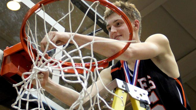 Silverton's Sam Roth (25) cuts a piece of the net following the Silverton vs. Wilsonville boy's basketball OSSA Class 5A tournament championship game at Gill Coliseum in Corvallis, Ore., on March 13. Silverton won the championship 33-32.