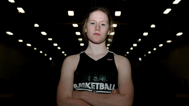 Delaney Henery, a junior basketball player, stands for a portrait at West Salem High School on Thursday, Dec. 10, 2015.