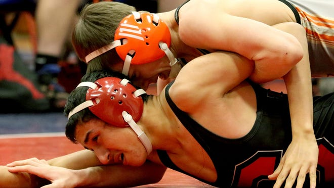 Dallas' Joseph Foster, top, and Central's Manuel Martinez compete in the 120 pound weight class during a wrestling meet at Lebanon High School in Lebanon, Ore., on Wednesday, Jan. 6, 2015.