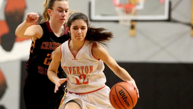 Silverton's Brooke McCarty (12) drives through Crescent Valley's Cali McClave (23) in the Crescent Valley vs. Silverton girl's basketball game at Silverton High School on Wednesday, Jan. 13, 2015.